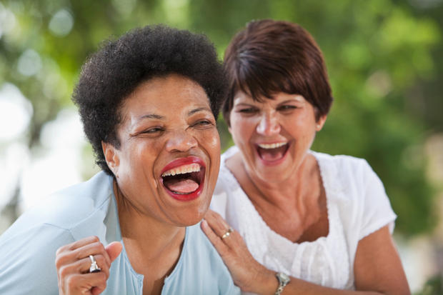 Mature women laughing