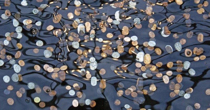 coins throw into fountains
