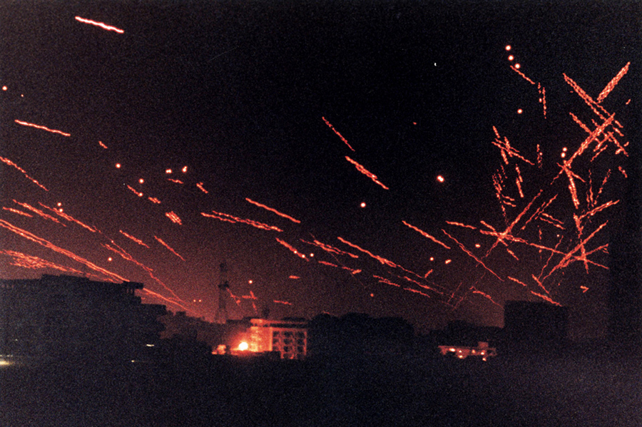 TRACER FIRE LIGHTS THE SKY IN A FILE PHOTO OF THE FIRST ATTACK ONBAGHDAD IN THE GULF WAR.