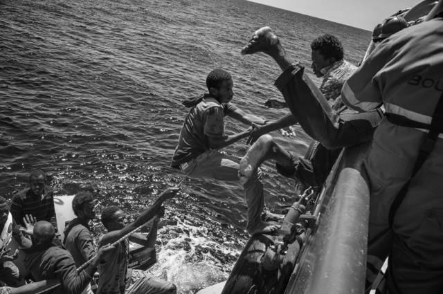 إنقاذ مهاجرين ليبيين