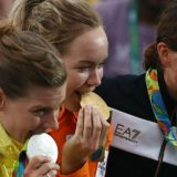Olympians Bite Their Medals