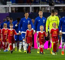 soccer players walk kids